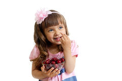 Little girl with cherry berries isolated stock photography