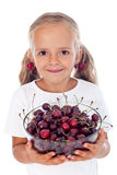 Little girl with cherry earrings Stock Image