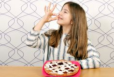 Little girl with cherry pie Stock Photos