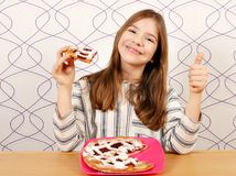 Little girl with cherry pie Stock Image