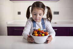 Little girl with cherry tomatoes bowl Royalty Free Stock Photography