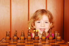 Little girl and chess Stock Images