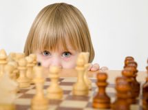 Little girl and chess Stock Photo
