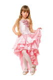 Little girl in a chic pink dress Royalty Free Stock Image
