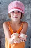 Little girl with chicken eggs Stock Image