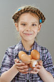 Little girl with chicken eggs Stock Photo