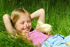 Little girl with a chicken Stock Photo