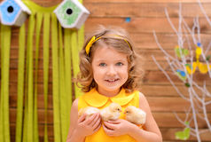 Little girl with chickens indoors royalty free stock photography