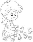 Little girl and chicks. Smiling child playing with her small funny chickens, a black and white vector illustration in a cartoon style for a coloring book Stock Photo