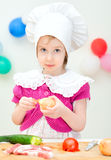 Little girl in chief hat Royalty Free Stock Photography