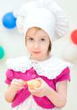 Little girl in chief hat Stock Images