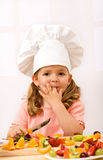 Little girl chief making fresh fruit salad Stock Photography