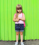 Little girl child with backpack Royalty Free Stock Photography