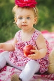 Little girl child with big paint eyes in a dress Stock Photo