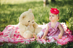 Little girl child with big paint eyes in a dress Royalty Free Stock Images