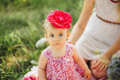 Little girl child with big paint eyes in a dress Royalty Free Stock Image