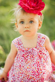 Little girl child with big paint eyes in a dress Stock Photography