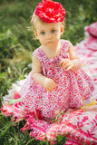 Little girl child with big paint eyes in a dress Royalty Free Stock Photo