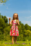 Little girl child blowing bubbles outdoor. Kid having fun in park. Happy and carefree childhood stock photo