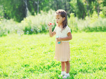 Little girl child blowing soap bubbles in summer Royalty Free Stock Photography