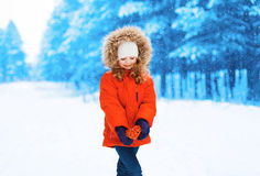 Little girl child with heart in hands outdoors Stock Image