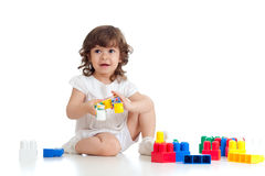 Little girl child kid with construction set Royalty Free Stock Photo