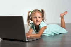Little girl child with laptop stock photos
