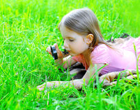 Little girl child looking through a magnifying glass Royalty Free Stock Photos