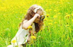 Little girl child looking through a magnifying glass Royalty Free Stock Photo