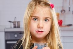 Little girl child milk moustache kid glass healthy eating Royalty Free Stock Photos