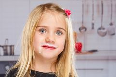 Little girl child milk moustache kid healthy eating Royalty Free Stock Photos