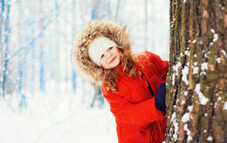 Little girl child playing in snowy winter Stock Photos