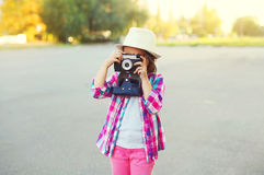 Little girl child with retro camera doing snapshot Royalty Free Stock Images