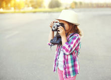 Little girl child with retro camera doing snapshot Stock Photography