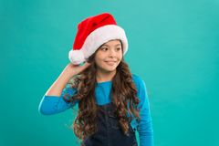 Little girl child in santa hat. Present for Xmas. Childhood. New year party. Santa claus kid. Happy winter holidays. Small girl. Christmas shopping. Are you royalty free stock image