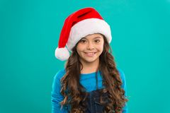 Little girl child in santa hat. Present for Xmas. Childhood. New year party. Santa claus kid. Happy winter holidays. Small girl. Christmas shopping. New year stock image