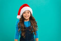 Little girl child in santa hat. Present for Xmas. Childhood. New year party. Santa claus kid. Happy winter holidays. Small girl. Christmas shopping. Fill our royalty free stock image