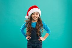 Little girl child in santa hat. Present for Xmas. Childhood. New year party. Santa claus kid. Happy winter holidays. Small girl. Christmas shopping. Christmas royalty free stock photo