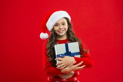 Little girl child in santa red hat. New year party. Santa claus kid. Present for Xmas. Childhood. Happy winter holidays. Small girl. Christmas shopping. New royalty free stock photography