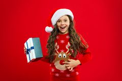 Little girl child in santa red hat. New year party. Santa claus kid. Present for Xmas. Childhood. Happy winter holidays. Small girl. Christmas shopping. red is stock photos