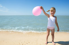 Little girl child on the sea Stock Images