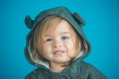 Little girl child smiling. Cheeky little girl. small happy girl. autumn and spring kid fashion. childhood and happiness. Having fun. Little treasure. funny royalty free stock photography