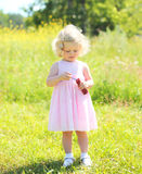 Little girl child with soap bubbles in sunny summer Royalty Free Stock Images