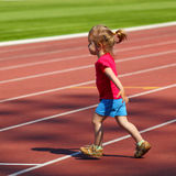 Little girl child at the stadium. Little girl child involved in athletics at the stadium Royalty Free Stock Photography