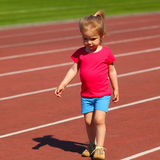 Little girl child at the stadium. Little girl child involved in athletics at the stadium Stock Image