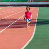 Little girl child at the stadium. Little girl child involved in athletics at the stadium Stock Images