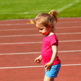 Little girl child at the stadium. Little girl child involved in athletics at the stadium Royalty Free Stock Images