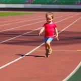 Little girl child at the stadium. Little girl child involved in athletics at the stadium Stock Photo