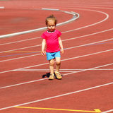 Little girl child at the stadium. Little girl child involved in athletics at the stadium Stock Photography
