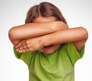 Little girl child teenager covering her face Stock Photos
